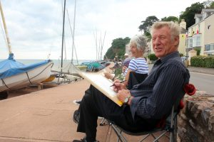 Jane and Ray Gratton sketching the boats at Shaldon