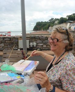 Rosemary More adding some sunshine in oils to her view of Shaldon Beach