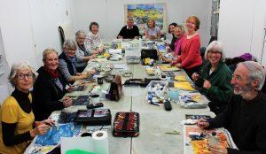 TAS members working on their individual squares of the Van Gogh painting